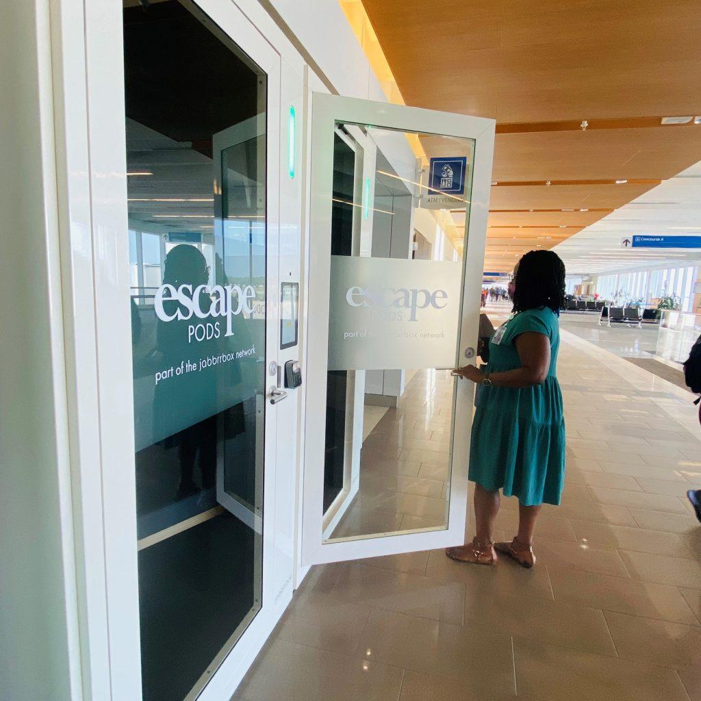 Woman enters Escape Pod private workspace