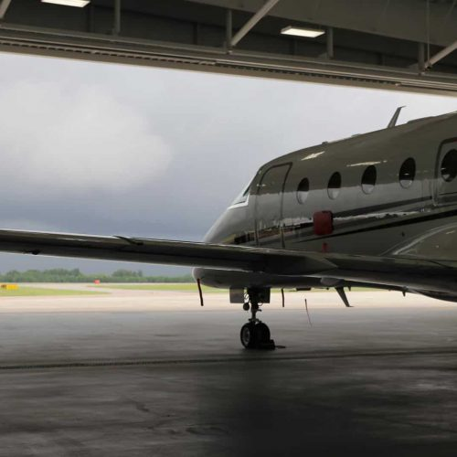 Private jet in hangar on cloudy day at GSP airport